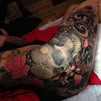 Awesome full side tattoo by Jeff Gogue