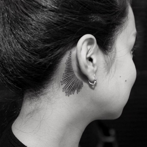 Cute behind the ear tattoo!