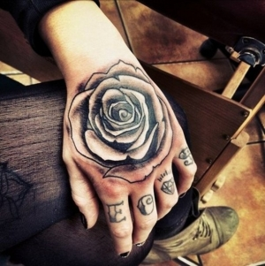 Hand rose tattoo idea
