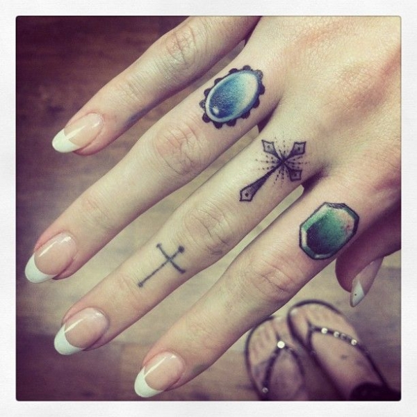 Finger tattoos by Cally Jo