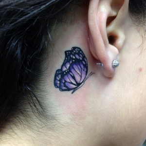 Tiny butterfly tattoo