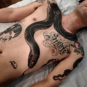 Huge snake tattoo by Zac Scheinbaum