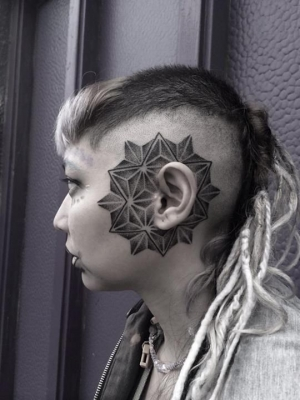Mandala ear tattoo by Corey Divine