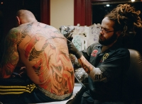 Tattoo artist Adrian Lee at work