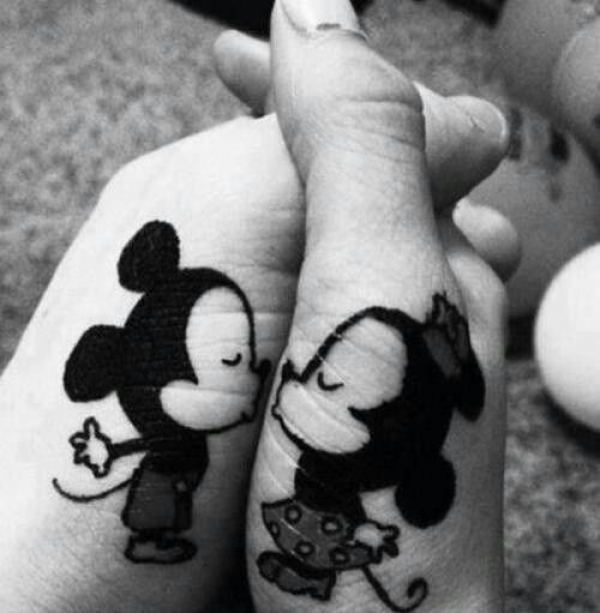 Mickey and Minnie kiss
