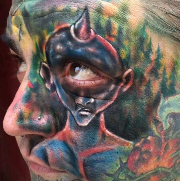 Johnny Smith with a crazy face tattoo with a cyclops!