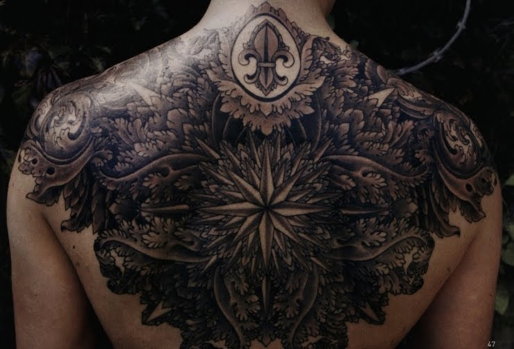 Huge upper back black star by Thomas Hooper