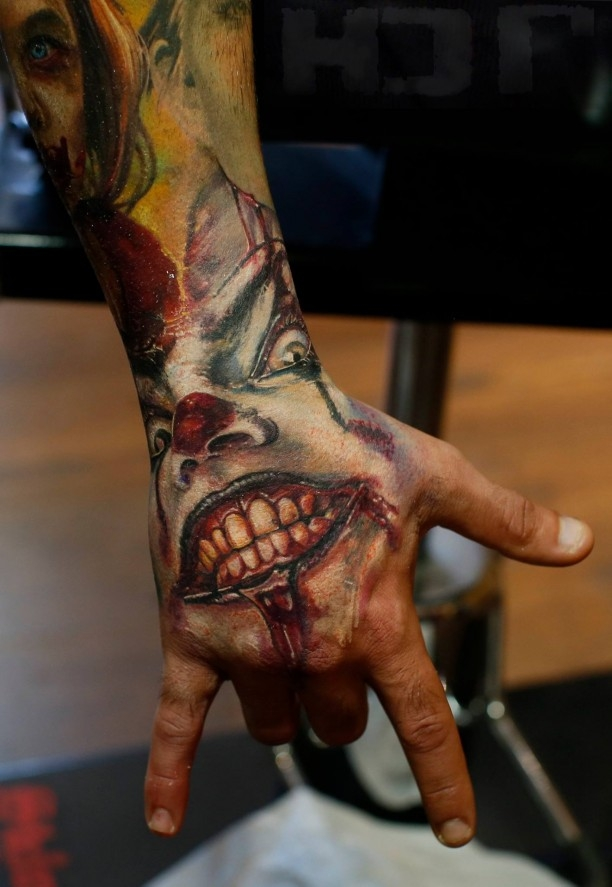 Super creepy clown hand tattoo