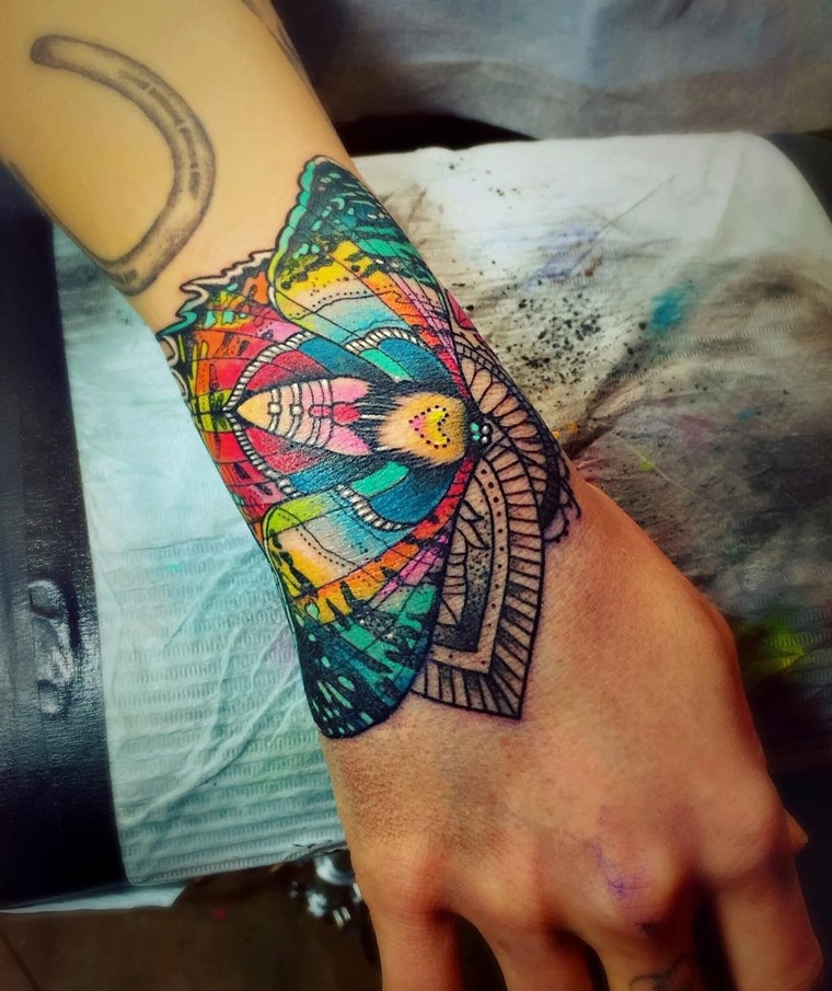 AWESOME moth wrist tattoo