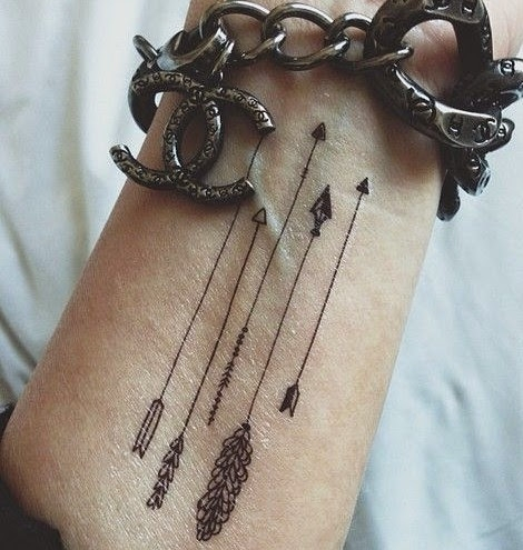 Tiny arrows tattoo
